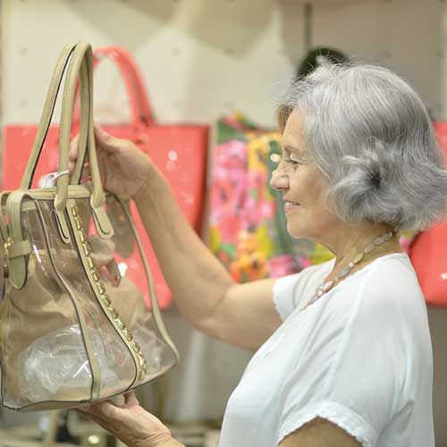 Resale Shop - Lady Shopping Purses