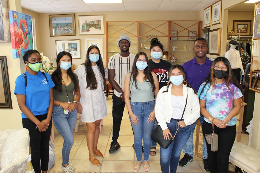 Tutor Corps students shop for future at Guadalupe Resale Shop